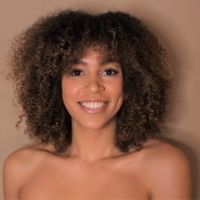 afro natural hair cut mid long woman